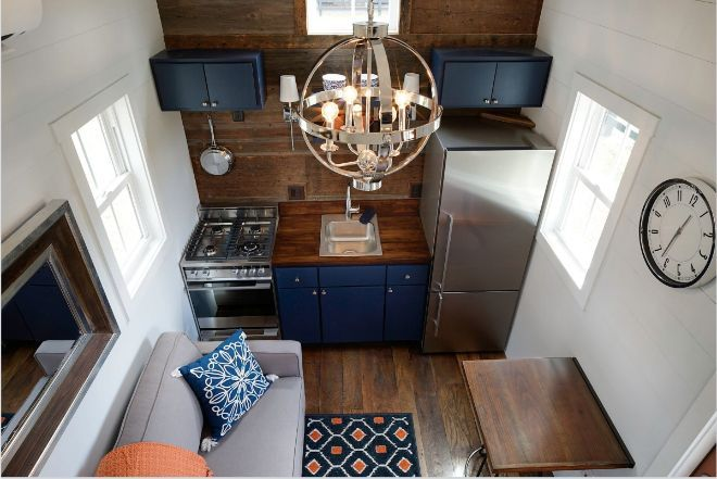 Driftwood Homes USA designs the Indigo. An incredibly ample tiny house on wheels with more than one surprise inside.