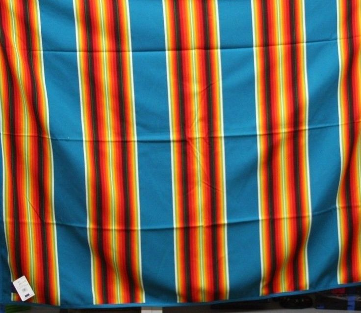 """Title: Pendleton Beaver State Serape Style Southwest Reversible Wool Blanket 64""""x80""""""""Sunburst Over The Ocean """". Pendleton WOOL Blanket / Throw Beaver State Robes & Shawls Serape Style. Wool blanket/throw approximate measurement 64"""" x 80"""", reversible to the same pattern with contrasting colors, brightly colored earth tones in blues, reds, oranges, whites, green and yellow. 