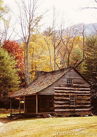 Log Cabin among Autumn Trees