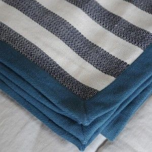 Her Shed Cotton Throw/ Picnic Blanket $99.00 These natural cotton throws with fringe detail are classically stylish and so versatile - use on the bed or sofa, as a table cloth or even a picnic blanket.  They are trimmed with a contrast twill ribbon and velvet ribbon and measure 190 x 130 cm.
