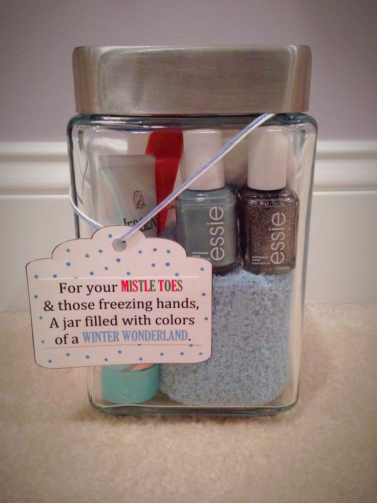 DIY Nail Polish Christmas Gift. Inside contains: Two Essie nail lacquers (Parka Perfect and Ignite the Night), a nail file, nail polish remover, a pack of regular cotton rounds, Jergens Original Scent lotion, and a pair of fuzzy socks.