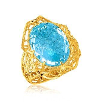 Italiensk Designad 14K Gult Guld Ring med Oval Blå Topas. www.tessard.se