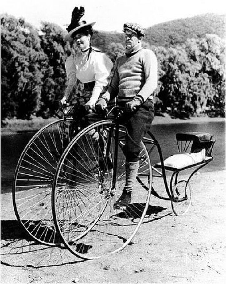 circa 1910- double bicycle with a baby carrier...Nothing to keep the baby from rolling out