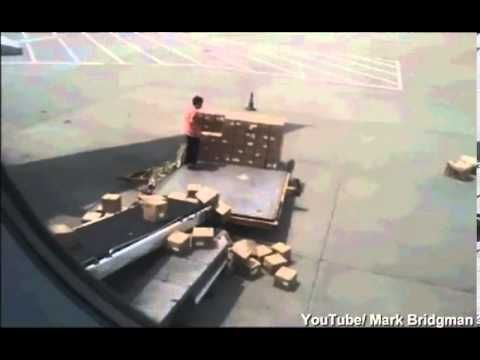 Handle with care? Hilarious video reveals Chinese freight workers throwi...