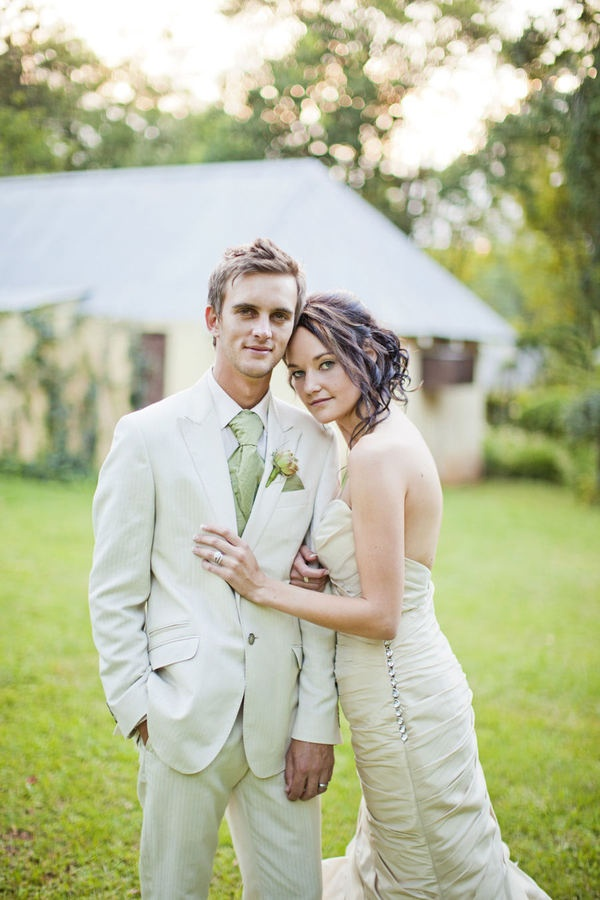 Green and cream wedding featuring green grooms attire