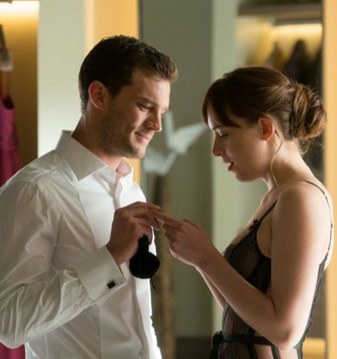 Christian gives Ana her earrings for the masquerade ball