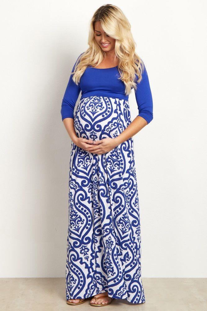 A solid top, damask bottom maternity maxi dress. Rounded neckline. Cinched under bust. Double lined in bust area. 3/4 sleeves. This style was created to be worn before, during, and after pregnancy.