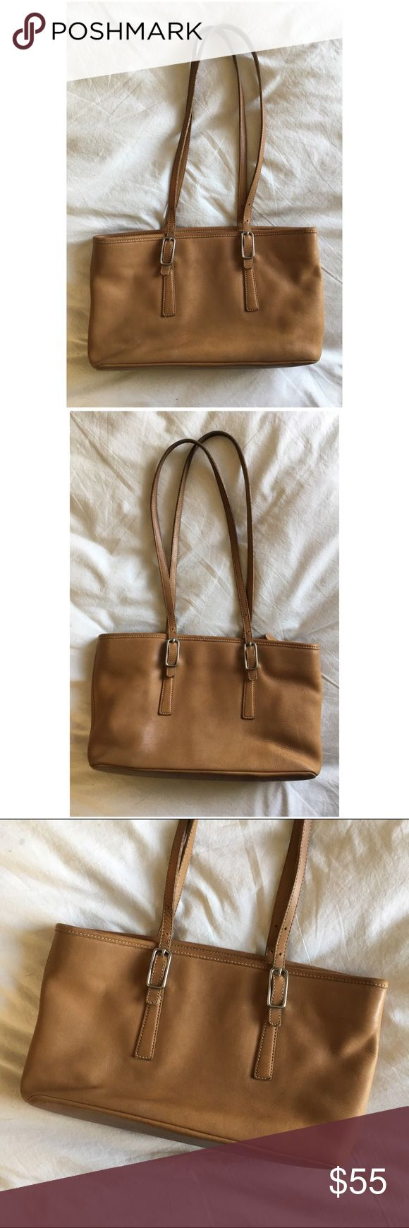 "Vintage tan coach-- newly conditioned! This is a lovely vintage coach bag in great condition. This bag is from the late 90s, early 2000s. The leather is soft, supple and newly conditioned! There is some wear since it is an older piece, but it has no major stains, tears, scratches, etc. It is, however, missing its hang tag. The tops of the handles are slightly darker as they have patinaed somewhat over time. Strap drop: 12.5"", height: 7.5"", length: 13"", depth: 3.5"". Made in the USA! Coach…"