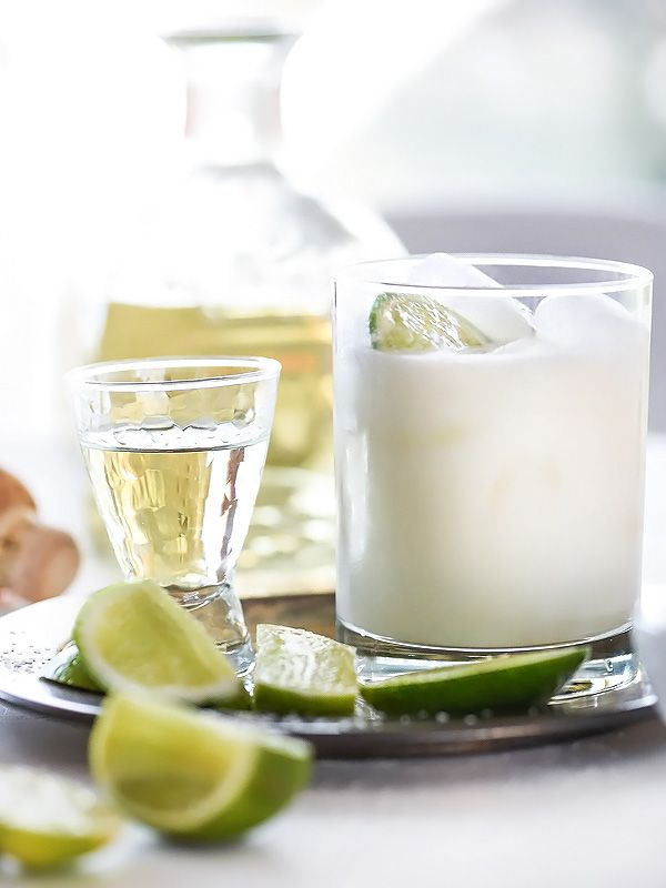 The Best Coconut Margarita | foodiecrush.com -  Ingredients      1½ ounces Patron reposado tequila     ½ ounce cointreau     1 ounce coconut cream     1 ounce coconut milk     ½ ounce fresh lime juice     Splash of half and half     Splash of simple syrup (1/2 cup sugar, ½ cup water brought to a boil until sugar dissolved, then cooled.)     lime wedges for garnish