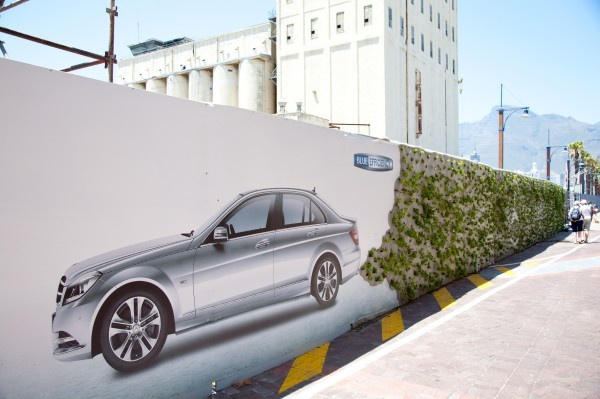"Mercedes' vertical garden billboard, Cape Town: The vertical garden or ""living wall"" concept involves installing a light steel grid up against a vertical surface, into which recycled plastic bottles are inserted and filled with soil, plants and flowers."