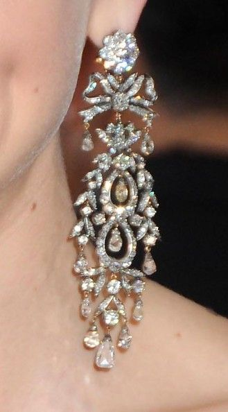 """Best Actress Nominee (2010) Carey Mulligan's dark Prada gown with cutaway hem was perfectly accented with 19th century cascading diamond and diamond briolette earrings and a delicate Everlon Diamond Knot Ring, all by Fred Leighton. """"These earrings came into our collection a week before the Oscars,"""" says Rebecca Selva of Fred Leighton, """"and from the moment we saw them we knew they were for Carey."""""""
