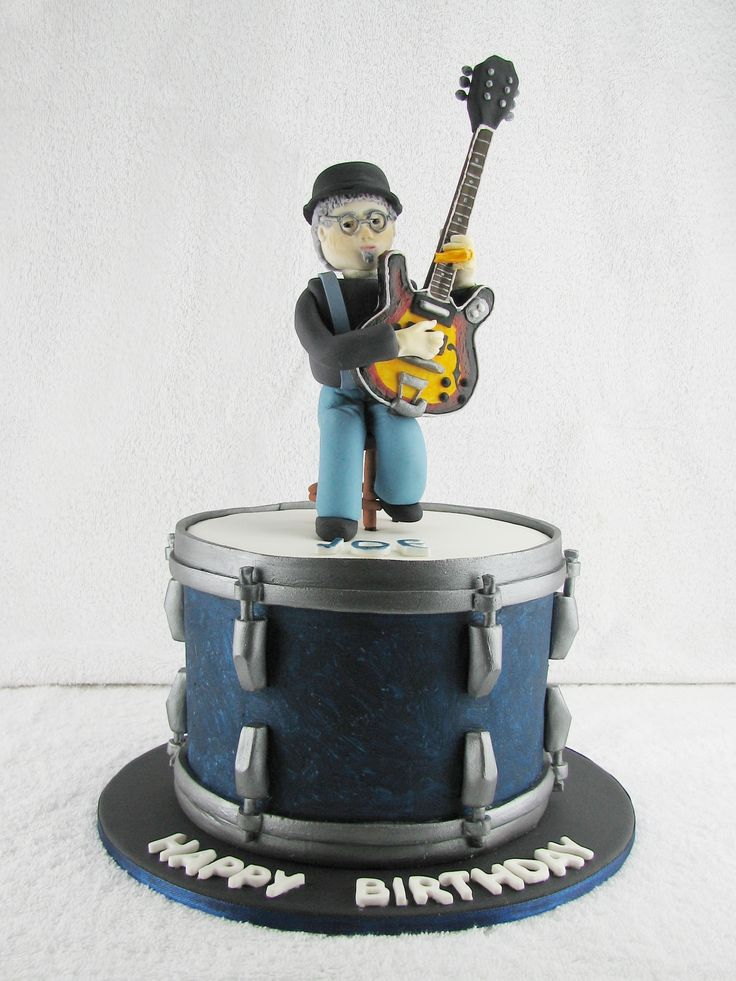 Drum and guitar cake: Homesick Joe is a great musician and friend of my brother. For him I have made a small chocolate mudcake with milk chocolate ganache filling and covered in fondant in the form of a drum. Sitting on the drum cake is a fondant figurine that looks something like his profile picture at the moment. www.facebook.com/cakesbyleannerhodes
