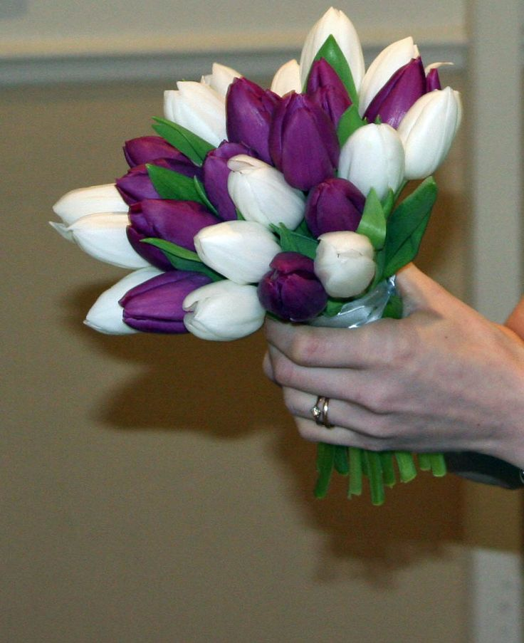 Purple tulips for the bride, white for the bridesmaids, and these for the maids of honor :)  but with pink