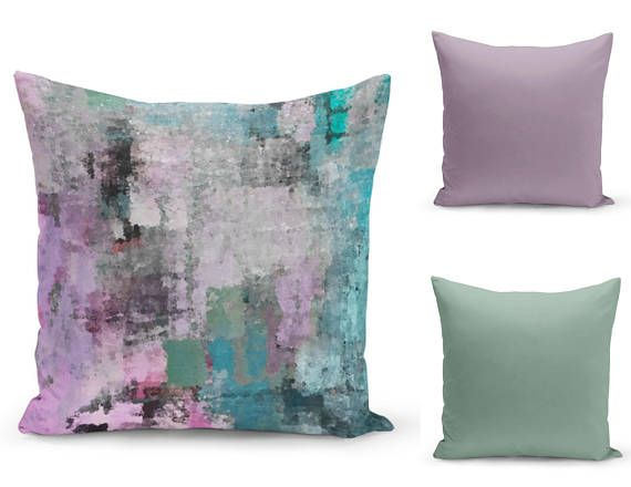 Mix and match pillow covers. Main cover is a pattern print in shades of purples, teal, aqua, green, black and more! Optional cooridinating solid covers. Individually cut and sewn, features a 2 sided print and is finished with a zipper for ease of care. SIZES: 16in. X 16in. 18in. X