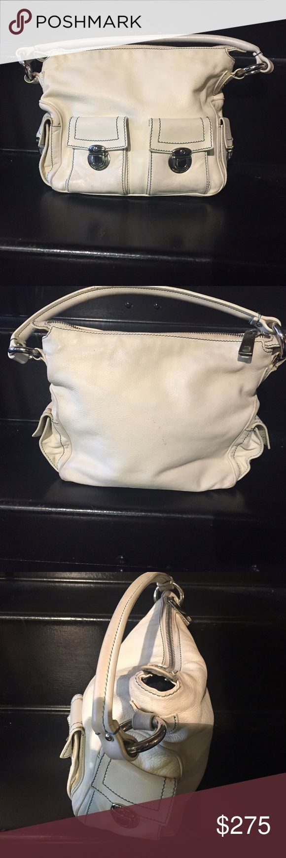 Marc Jacobs cream shoulder bag w/ silver hardware 100% Authentic Marc Jacobs cream shoulder bag with silver hardware and blue stitching detail. Price reflects Pre-loved condition. Some scratches on interior walls from use. Overall good condition. Classic bag great for Spring/Summer. Note this is Marc Jacobs not Marc by Marc Jacobs. This bag originally came in 2 sizes this is the smaller of the 2 and not the XL oversize version. Make an offer! Marc Jacobs Bags