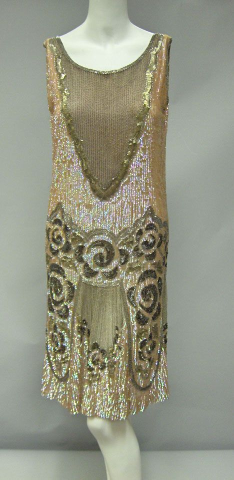 "Beaded flapper dress (1920s) In iridescent pink. Metallic sequins, bugle beads and metallic embroidery on tulle, with rose"" pattern, plunging back."