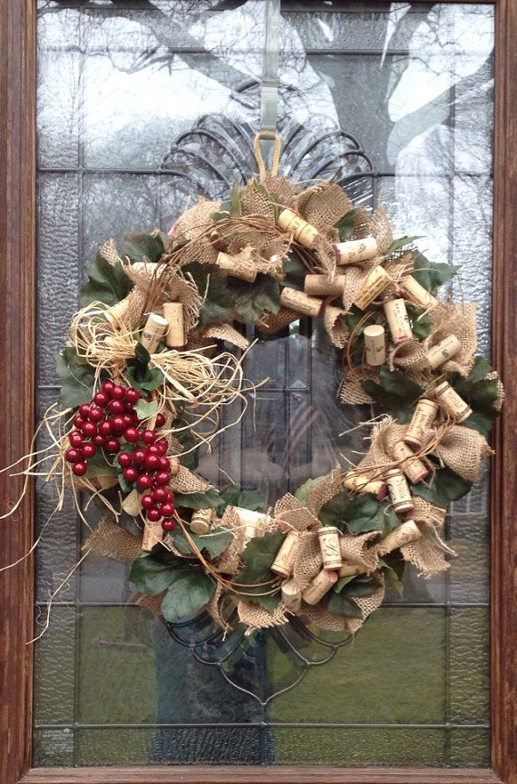 Grapevine leaves, burlap, raffia, faux grapes,and loads of wine corks make up this wine cork wreath. It measures approximately 22 inches in diameter