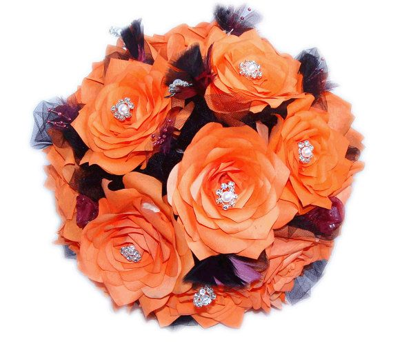 Dark orange or persimmon and plum handmade coffee filter paper roses make up this bouquet. We have added pearl and rhinestones to the center of the top Roses for added glamour. There are black and plum tulle and pearl flowers and delicate feathers between the flowers. The handles are wrapped in plum ribbon, black rhinestone ribbon and organza flowers.
