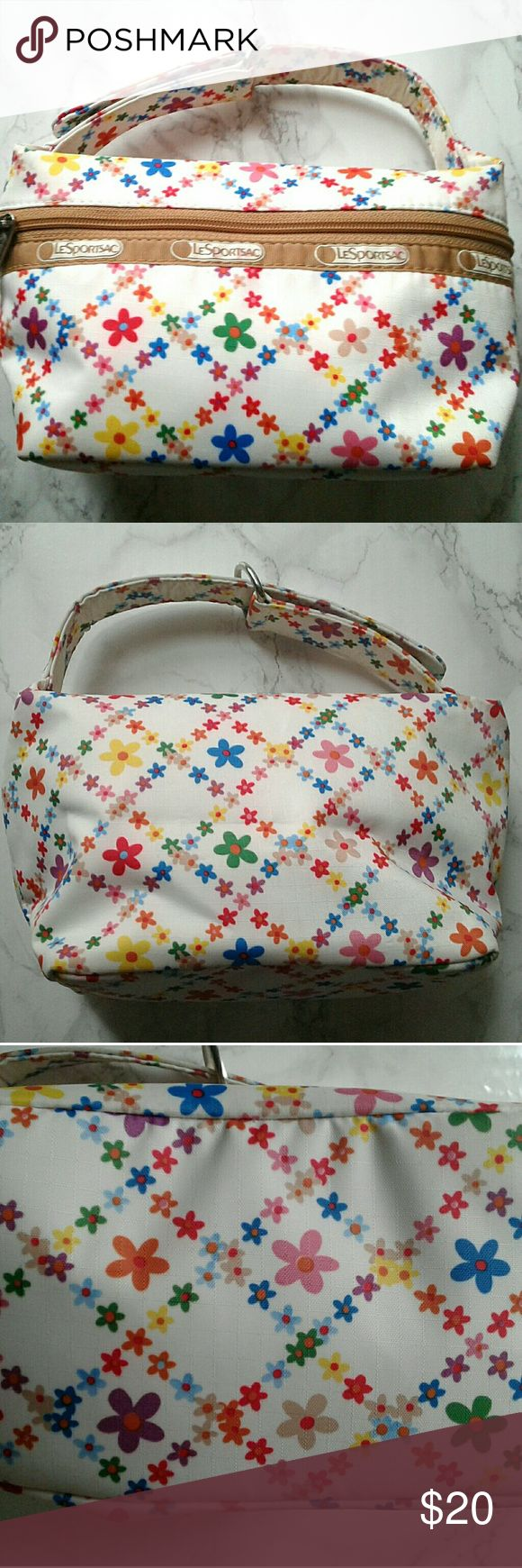 Floral LeSportsac bag Cute little Lesportsac bag. In good condition besides the small marks on the logo on the front, the tape mark in side, and under the handle (can be hand washed with soap) LeSportsac Bags