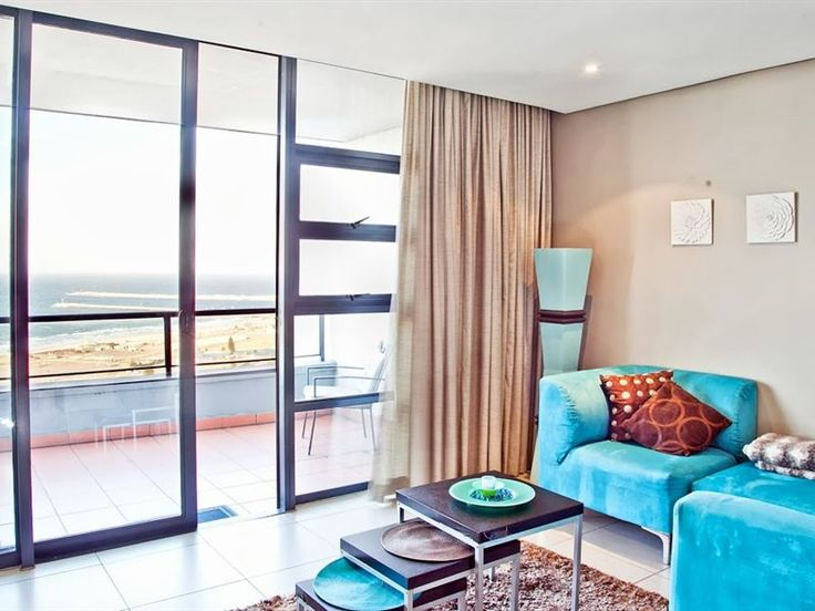 214 on Spinnaker - Wake up to the sight of the ocean at 214 On Spinnaker; a modern self-catering apartment with wonderful sea and harbour views.  Situated on the 21st floor of The Spinnaker building at the Point Waterfront ... #weekendgetaways #durban #dolphincoast #southafrica