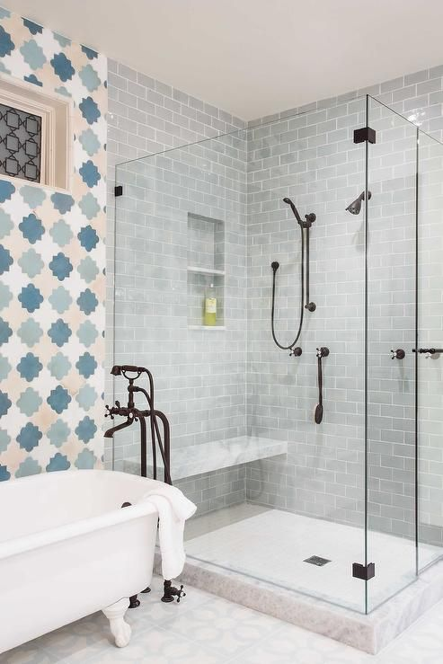 Blue And Gray Bathroom Boasts A Claw Foot Tub And A Bronze