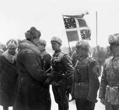 Swedish Volunteers being greeted by Finnish Officers.