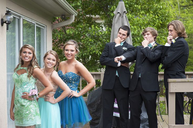 Prom poses. Second dress on the left.
