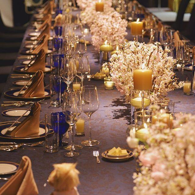 recruit_holdings on Instagram pinned by myThings 【ゲストテーブル】 縦長のテーブルで統一し、晩餐会のような雰囲気にこだわったSさん。友人たちからは「ここまで装花にこだわった結婚式は初めて」とうれしいコメントをもらったそう。ネイビーのテーブルクロスにピンクの桜が映え、ほのかに揺れるキャンドルがよりロマンチックな気分を高めて。  #ゼクシィ #結婚 #ブライダル #ウェディング #ゲストテーブル #flower #Wedding #bridal #Happy #Love #RECRUIT