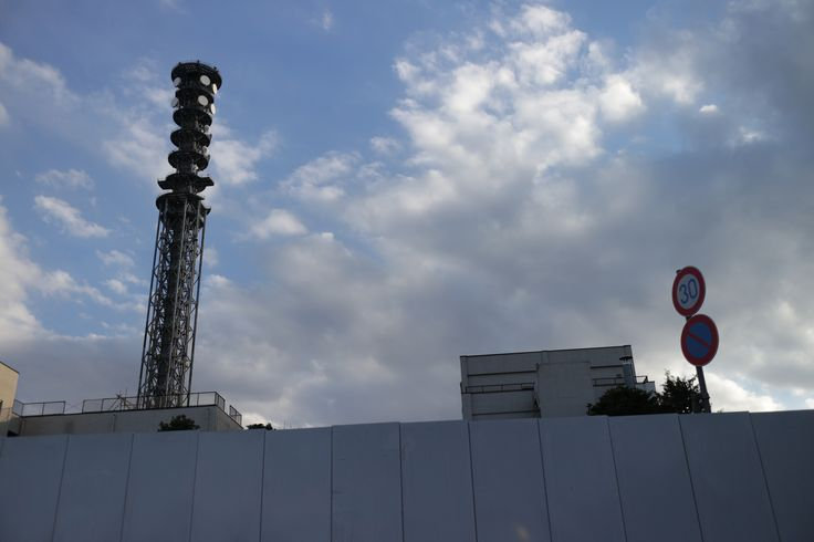 https://flic.kr/p/QXuAdc | radio tower | sky, fense, and traffic signs.