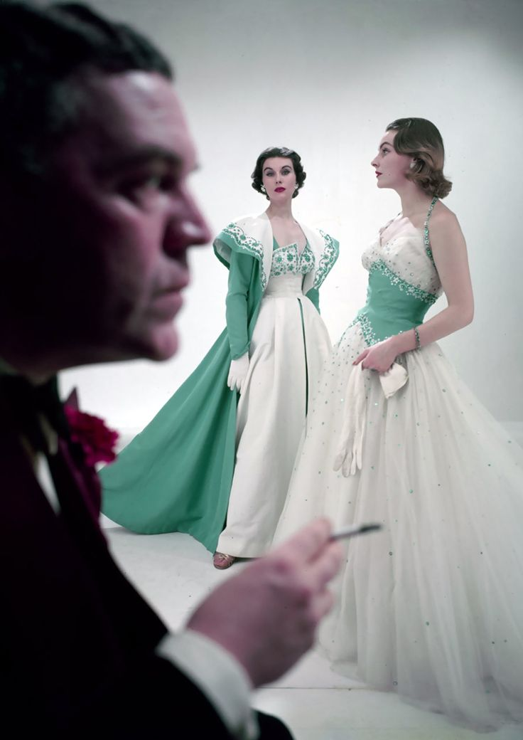 Norman Hartnell with models wearing his designs, 1953. Photo: Norman Parkinson.