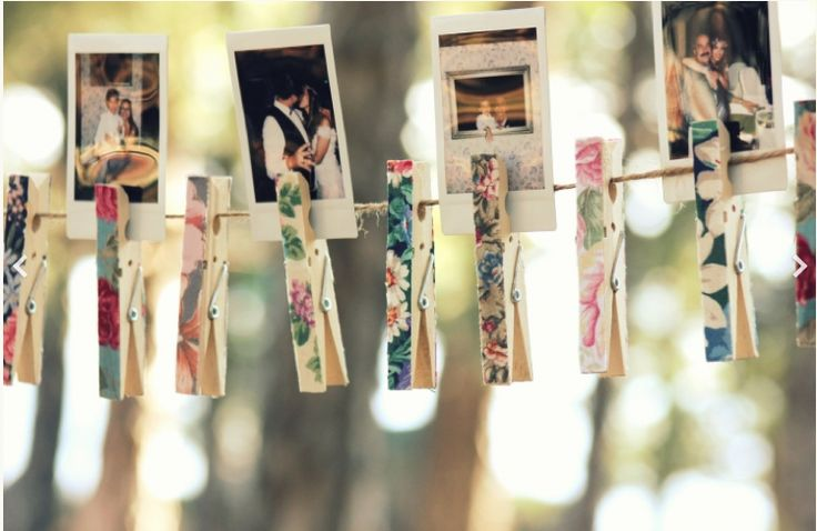 Polaroid's + string & clips = perfect for weddings. Maybe not polariods though and just pictures of us and family. :)