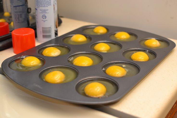 Use a Whoopie Pie Pan to bake eggs, and also use a spatula to break the egg yolk so it flattens and spreads some in the egg white