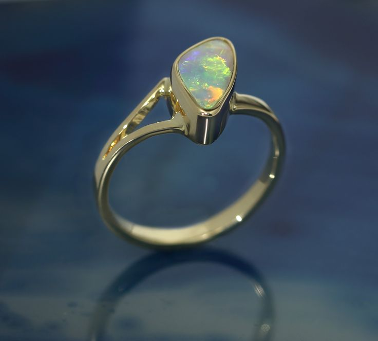 Coming Soon to my Etsy Store. Beautiful Crystal Opal in Solid Gold ring. Split shank going into single band. Very nice design and free form shape stone.