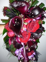 Gothic style Bouquet - Black Ostrich Feathers, Eggplant Calla Lilies with crystal features, Red Roses, Gloriosa & purple vanda Orchids