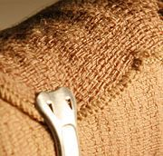 DIY body wrap.  Elastic bandages are the key to a body wrap. Get plenty. Because the included clip may scratch or stab you can secure it with safety pins.