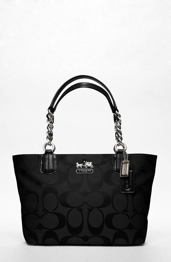 Coach. Looks eerily similar to a Coach bag I had a few years back. :)