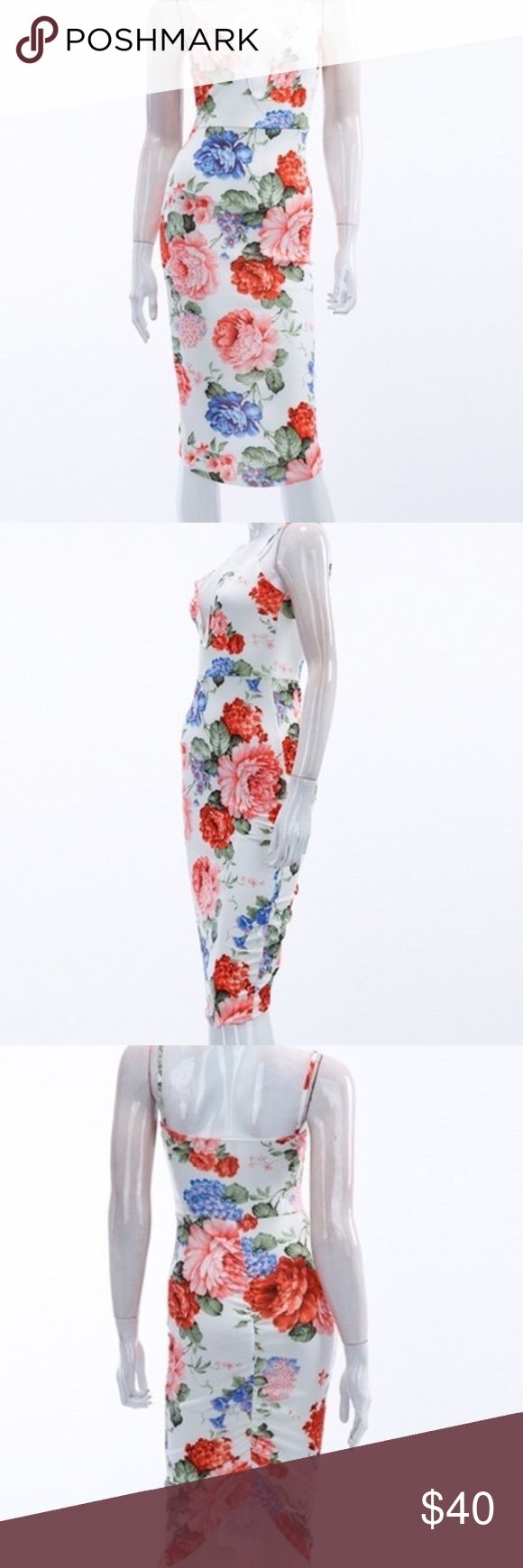 """"""" COMING SOON""""Stylish Floral body con dress Beautiful floral dress, deep V , polyester& Spandex. Perfect for spring and summer Auditions Dresses Midi"""