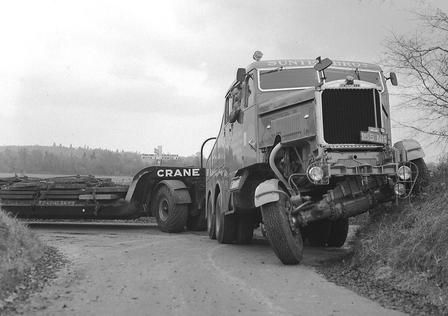 It appears to be a roadtest of a new Crane low loader with one of Sunter Bros Scammells. The truck is trying to turn into a narrow lane near Norwich (see the road sign on Expando-Vision--j