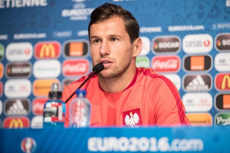Grzegorz Krychowiak Photos Photos - In this handout image provided by UEFA, Grzegorz Krychowiak of Poland attends a press conference on June 21, 2016 in Saint-Etienne, France. - Euro 2016 - Poland Press Conference