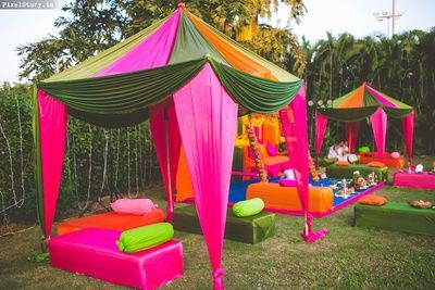 Colorful draped decor tents for mehendi ceremony