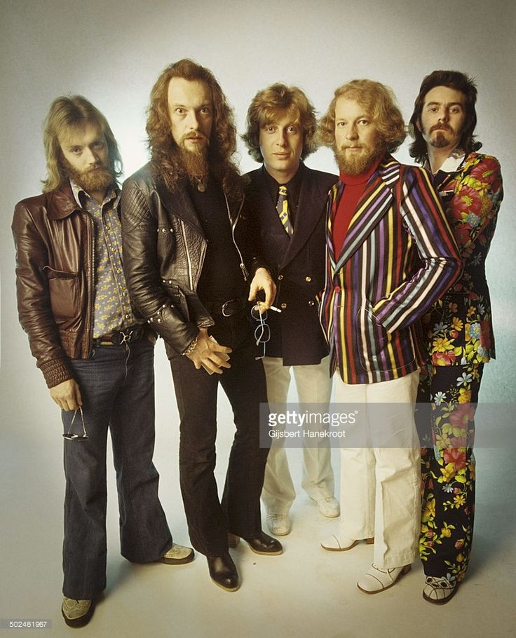 Jethro Tull posed in Amsterdam, Netherlands in 1972. Left to right: John Evan, Ian Anderson, Barriemore Barlow (Barrie Barlow), Martin Barre, Jeffrey Hammond.