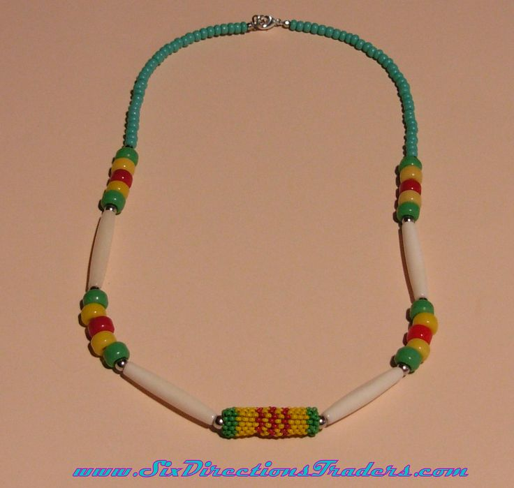 22 inch Vietnam Veteran colors Necklace ~ Strung on Softflex Heavy Beading wire with Bone Hairpipe, Glass Crow Beads, Metal Round spacer beads, Seed Beads, and Lobster clasp. The center is a Peyote stitched bead of small glass seed beads that is about 1 1/4 inches.