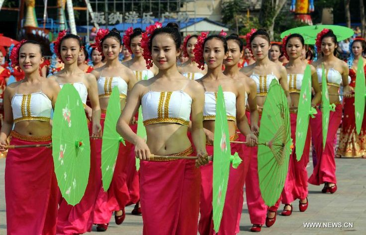 People of Jinuo ethnic group perform during a cultural demonstration to celebrate the New Year of Dai ethnic group in Jinghong City, Dai Autonomous Prefecture of Xishuangbanna, Yunnan Province, April 14, 2015. Over 5,000 local people took part in the demonstration, presenting traditional arts and dances http://www.chinatraveltourismnews.com/2015/04/new-year-of-dai-ethnic-group-celebrated.html