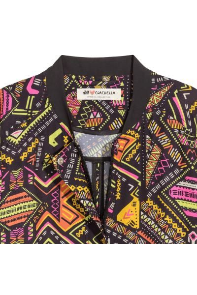 Patterned bomber jacket: H&M LOVES COACHELLA. Bomber jacket in an airy, patterned weave with a small stand-up collar, a concealed zip and wind flap, side pockets, a drawstring at the hem and elasticated cuffs. Unlined.