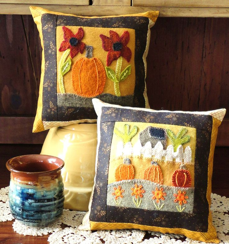 Patterns to make two little eight inch pillows. Use beautiful hand dyed wools and silk embroidery floss to embroidery fall pumpkins, flowers and a cozy little house.