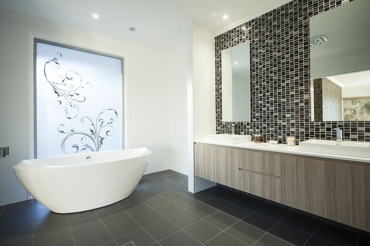 Bathrooms are always a great place to make a statement in a house. Loving the colour palette in this stunning bathroom!