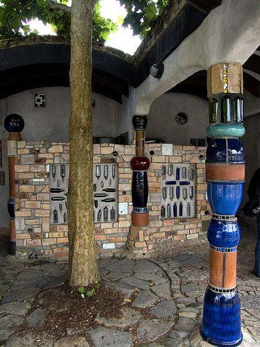 Kawakawa, New Zealand Public Toilet.  Details of the pillars made up of pots n bottles...