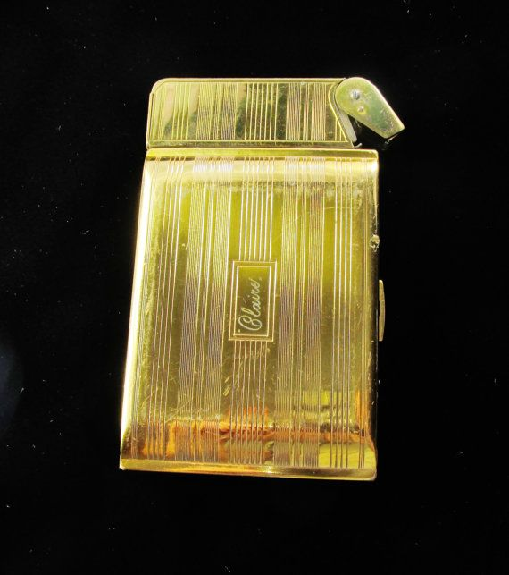 Hey, I found this really awesome Etsy listing at https://www.etsy.com/listing/201160074/vintage-cigarette-case-with-lighter-gold