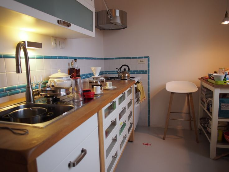Vancura family Apartment remodel / Prague / 2010 - the new kitchen..we used cheap white tiles around the counter and added more expensive maxican hand painted border tiles. The cabinets are from Ikea, but the counter is custom made, extra deep..