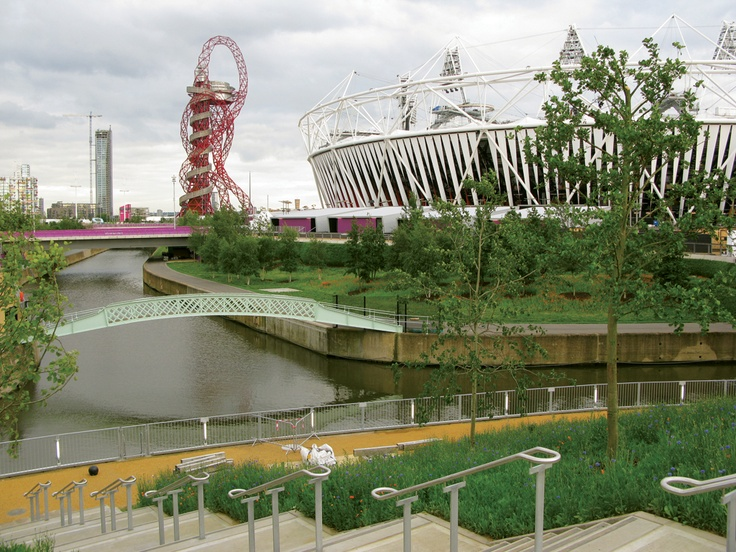 London 2012 Olympic Park: The main stadium is surrounded by wildflower meadows and a restored iron footbridge. Photo: Oliver Wainwright